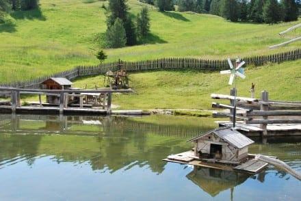 Family hiking Dolomites Italy alpine playgrounds