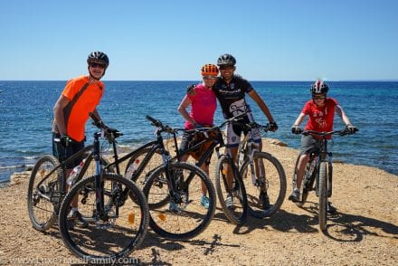 Family cycling on Ibiza with kids