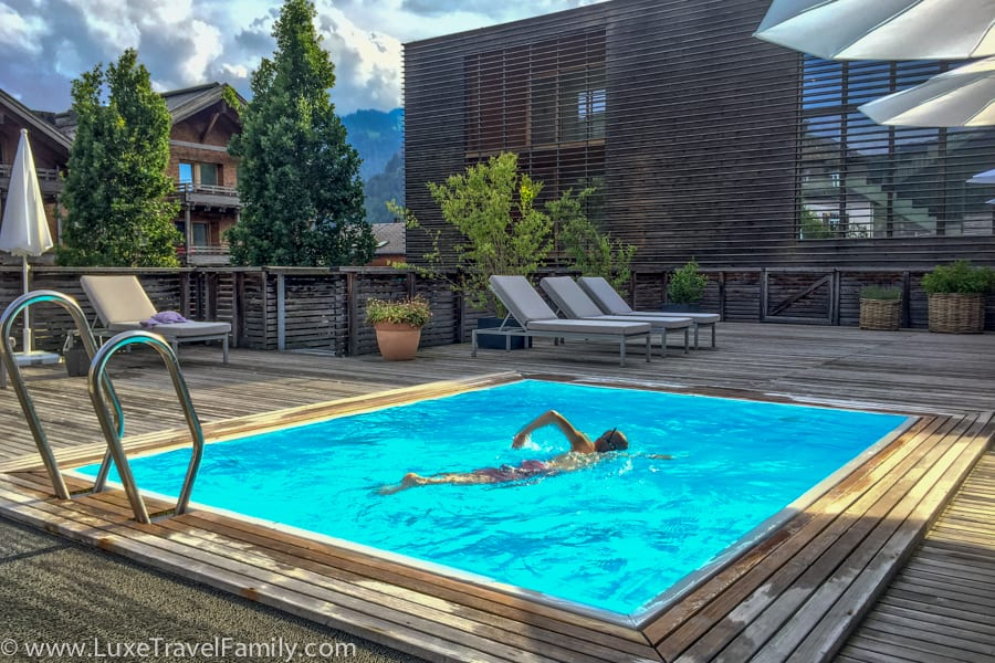 The outdoor pool at Hotel Post Bezau.