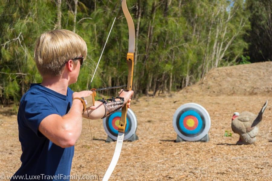 Boy practicing archery on Lanai Hawaii
