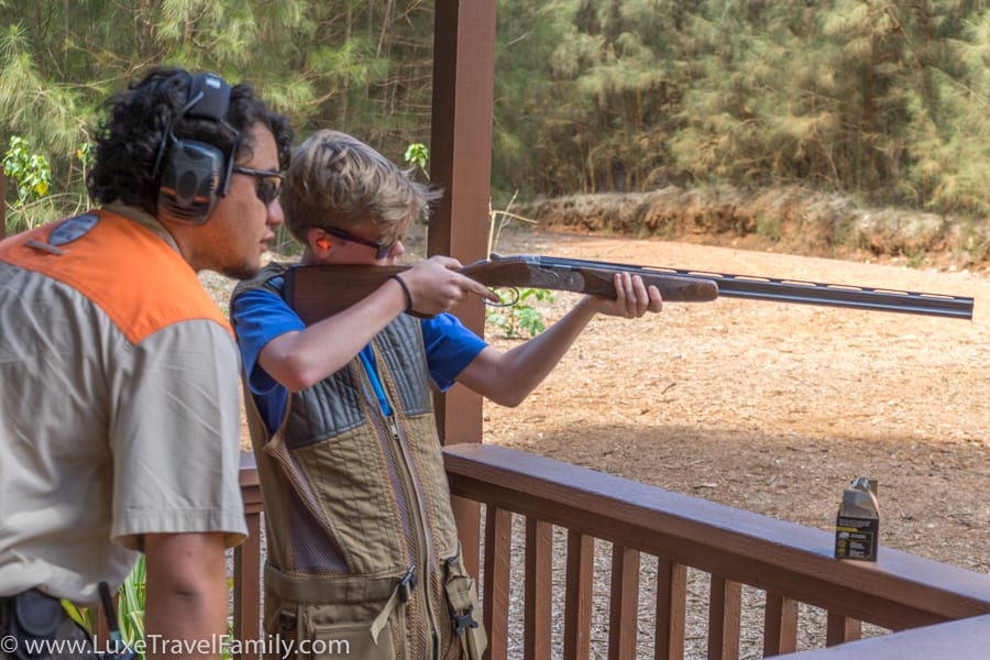 Boy learning to shoot sporting clays on Lanai Hawaii